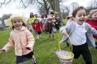 Happy children running during an Easter egg hunt.