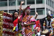 Children in colorful clothes wave on a float wave to the crowd during the annual Juneteenth parade in Philadelphia, Pennsylvania, on June 23, 2018.