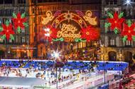 Ice Skating Rink in Mexico City Zocalo Christmas Night Celebration with Feliz Navidad on the wall.