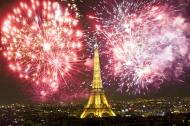 Eiffel tower Paris, France at night with fireworks.