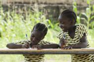 Two African girls doing school work.